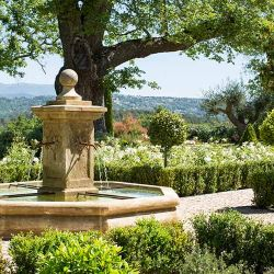 Water fountain in the gardens at La Bergerie, with stunning views of the landscape in the background